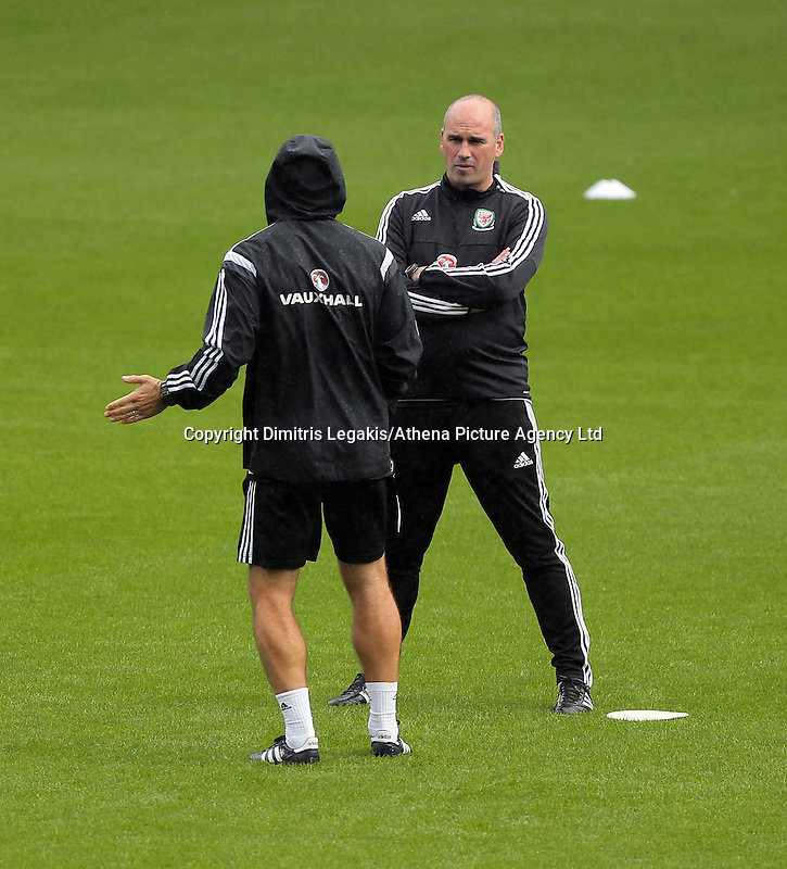 CARDIFF, WALES - SEPTEMBER 05: Performance psychologist Ian Mitchell (R) speaks to a colleague of his during the Wales training session, ahead of the UEFA Euro 2016 qualifier against Israel, at the Cardiff City Stadium on September 5, 2015 in Cardiff, Wales.