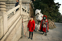 CHINA. Hubei Province. Wuhan. A Chinese performer outside of The Yellow Crane Tower which looks over the Yangtze and the city of Wuhan.Wuhan (population 4.3 million) is a sprawling city that sits on both sides of the Yangtze River.  2008