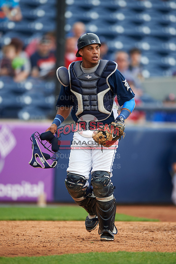 West Michigan Whitecaps catcher Franklin Navarro (12) backs up a play during a game against the Cedar Rapids Kernels on June 7, 2015 at Fifth Third Ballpark in Comstock Park, Michigan.  West Michigan defeated Cedar Rapids 6-2.  (Mike Janes/Four Seam Images)