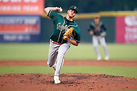 Starting pitcher Santiago Florez (30) of the Greensboro Grasshoppers in a game against the Greenville Drive on Thursday, July 22, 2021, at Fluor Field at the West End in Greenville, South Carolina. (Tom Priddy/Four Seam Images)