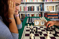 Italy. Lazio region. Frascati. Daniela Movileanu plays chess at the A.S.D. Frascati Scacchi, located in the public library of the Cocciano area of Frascati. Daniela Movileanu (born 1996) won twice the title of italian champion (under 14 years old, under 16 years old) at the Italian Chess Championship. Frascati is a town and comune in the province of Rome. It is located 20 kilometres south-east of Rome. Romanian immigration. 30.09.2011 © 2011 Didier Ruef