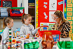 Laoise Rose and Shónagh Griffin on their first day of school at Scoil Nuachabháil, Ballymacelligott pictured with Junior Infants teacher Jackie O'Carroll .