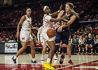 COLLEGE PARK, MD - DECEMBER 28: Izabel Verajao #34 of Michigan passes past Kaila Charles #5 of Maryland. during a game between University of Michigan and University of Maryland at Xfinity Center on December 28, 2019 in College Park, Maryland.