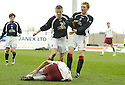 25/03/2006         Copyright Pic: James Stewart.File Name : sct_jspa14_falkirk_v_hearts.MARK TWADDLE IS PULLED BACK BY LIAM CRAIG AS ROMAN BEDNAR MAKES THE MOST OF AN INJURY....Payments to :.James Stewart Photo Agency 19 Carronlea Drive, Falkirk. FK2 8DN      Vat Reg No. 607 6932 25.Office     : +44 (0)1324 570906     .Mobile   : +44 (0)7721 416997.Fax         : +44 (0)1324 570906.E-mail  :  jim@jspa.co.uk.If you require further information then contact Jim Stewart on any of the numbers above.........