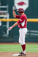 Arkansas Razorbacks first baseman Clark Eagan (9) celebrates after driving in a run against the Virginia Cavaliers in Game 1 of the NCAA College World Series on June 13, 2015 at TD Ameritrade Park in Omaha, Nebraska. Virginia defeated Arkansas 5-3. (Andrew Woolley/Four Seam Images)