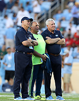 CHAPEL HILL, NC - SEPTEMBER 07: Senior Advisor to the Head Coach Darrell Moody of the University of North Carolina, retired former Head Coach Chuck Amato of North Carolina State University, and Head Coach Mack Brown of the University of North Carolina watch Miami warmup during a game between University of Miami and University of North Carolina at Kenan Memorial Stadium on September 07, 2019 in Chapel Hill, North Carolina.