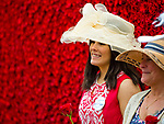 LOUISVILLE, KY - MAY 05: A woman dressed in her Derby finest poses in front of a wall of roses for a photo on Kentucky Derby Day at Churchill Downs on May 5, 2018 in Louisville, Kentucky. (Photo by Scott Serio/Eclipse Sportswire/Getty Images)