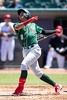 Great Lakes Loons shortstop Leonel Valera (8) follows through on his swing on May 30, 2021 against the Lansing Lugnuts at Jackson Field in Lansing, Michigan. (Andrew Woolley/Four Seam Images)