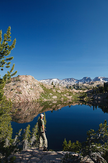 Backpacker stops to view the beartooth mountain range in the the beartooth wilderness area in montana