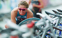 17 SEP 2011 - LA BAULE, FRA - A competitor watches her rivals go out onto the run as she puts on her running shoes in transition during the final round of the women's French Grand Prix Series at the Triathlon Audencia in La Baule, France (PHOTO (C) NIGEL FARROW)