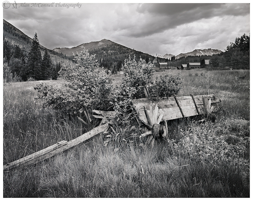 """""""Abandoned Wagon at Ashcroft""""<br /> Ashcroft Ghost Town <br /> Aspen, Colorado <br /> 2011<br /> <br /> <br /> With nature encroaching upon it, a primitive wagon rests outside the Ashcroft Ghost Town in the upper Castle Creek valley.  Prospectors arrived in 1880, and three years later Ashcroft had a population of about 2000.  By 1885, the mines' shallow deposits had been exhausted and only 100 people resided in Ashcroft during the summer.  Today, an interpreted walk along an old road provides access to the town's three original buildings and ten restored buildings.   <br /> <br /> 4 x 5 Large Format Film"""