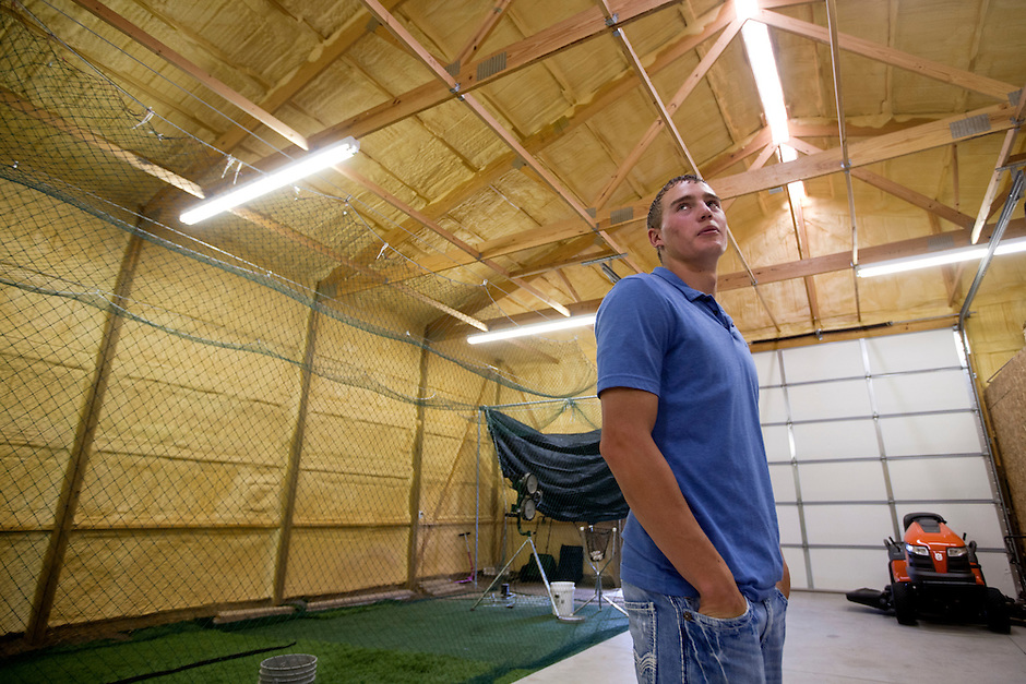 Brandon Nimmo gives a tour of his family's 2688 sq. ft. barn that houses a batting cage, at left, on Tuesday, June 21, 2011, in Cheyenne, Wyo. The New York Mets selected Nimmo No. 13 overall in the first round of this year's MLB draft. Now the recent high school grad must decide whether to go pro or accept an offer to play baseball at Arkansas in the fall. (Photo by James Brosher)