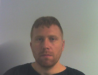 """Pictured: Police custody picture of Luke Jones<br /> Re: A """"jealous and possessive man"""" who murdered his ex-girlfriend in a rage over her seeing someone else has been jailed for 17 years.<br /> Luke Jones, of Milford Haven, attacked Natasha Bradbury at her Haverfordwest flat, in Pembrokeshire, in February.<br /> Swansea Crown Court heard she died from blunt force injuries, including cracked ribs, neck, brain and heart injuries.<br /> Jones, 33, had denied murder, claiming she was injured in a fall as they argued.<br /> In the days before the killing, the pair's relationship deteriorated when Miss Bradbury asked Jones if she could stay at a friend's house instead of seeing him.<br /> The prosecution said he then beat her to death after finding out she had been with another man after they split up."""