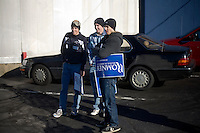 """Young Romney supporters stand in a parking lot after a rally for Republican presidential candidate Mitt Romney , former governor of Massachusetts, in Manchester, New Hampshire, on Sat. Dec. 3, 2011. The rally was called, """"Earn It with Mitt,"""" and was designed to bolster local efforts to help Romney """"earn"""" voters' support for the upcoming Republican primary."""