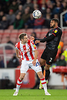 1st October 2021;  Bet365 Stadium, Stoke, Staffordshire, England; EFL Championship football, Stoke City versus West Bromwich Albion; Darnell Furlong of West Bromwich Albion heads the ball above Nick Powell of Stoke City