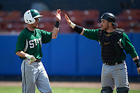 Farmingdale Rams shortstop Brandon Snow (1) high fives catcher Kenneth Johntry (18) during a game against the Union Dutchmen on February 21, 2016 at Chain of Lakes Stadium in Winter Haven, Florida.  Farmingdale defeated Union 17-5.  (Mike Janes/Four Seam Images)