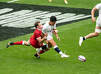 Marcus Smith (Harlequins) of England kicks through for the Henry Slade (Exeter Chiefs) of England try attempt during the Autumn International match between England and Canada at Twickenham Stadium, London, England on 10 July 2021. Photo by Liam McAvoy.