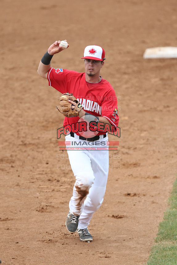 J.C. Cardenas (18) of the Vancouver Canadians chases a base runner in a run down during a game against the Eugene Emeralds at Nat Bailey Stadium on July 22, 2015 in Vancouver, British Columbia. Vancouver defeated Eugene, 4-2. (Larry Goren/Four Seam Images)