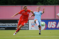 Heather O'Reilly (9) of Sky Blue FC plays the ball away from Abby Wambach (20) of the Washington Freedom. Sky Blue FC and the Washington Freedom played to a 4-4 tie during a Women's Professional Soccer match at Yurcak Field in Piscataway, NJ, on July 15, 2009.