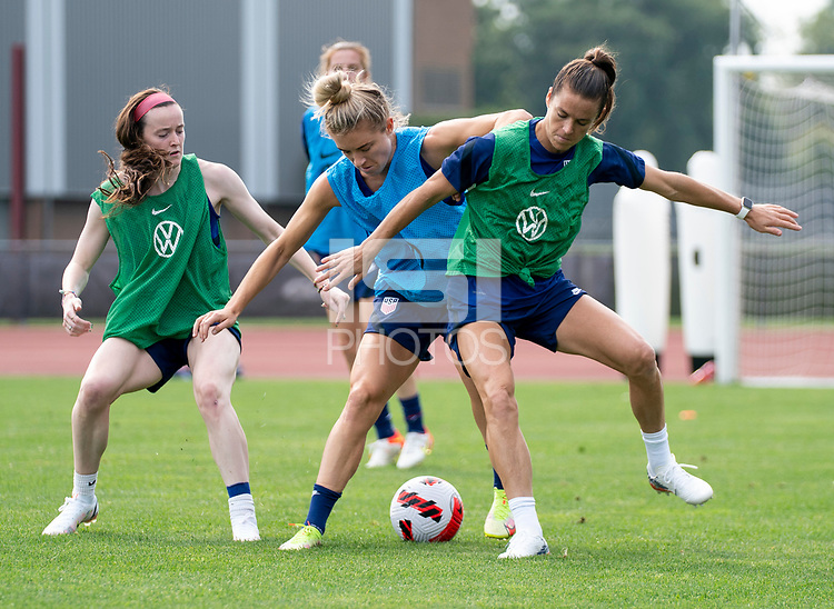 CLEVELAND, OH - SEPTEMBER 14: Kristie Mewis and Kelley O'Hara of the United States fight for the ball during a training session at the training fields on September 14, 2021 in Cleveland, Ohio.