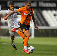 11th September 2021; Swansea.com Stadium, Swansea, Wales; EFL Championship football, Swansea versus Hull City; Greg Docherty of Hull City brings the ball forward while under pressure from Jamie Paterson of Swansea City