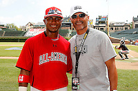 Shortstop Jesmuel Valetin #19 of Puerto Rico Baseball Academy in Manati, Puero Rico with his father, former major league player Jose Valentin, during the Under Armour All-American Game at Wrigley Field on August 13, 2011 in Chicago, Illinois.  (Mike Janes/Four Seam Images)