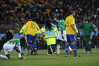 Kaka comforts teammate Elano, whi is stretchered off the field after a leg injury. Brazil defeated Ivory Coast, 3-1, in an important Group G match, Sunday, June 20th, at Soccer City Stadium in Johannesburg..