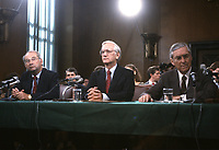 In this file photo from September 9, 1987, Judge William S. Sessions, United States President Ronald Reagan's designee to be director of the Federal Bureau of Investigation (FBI), center, is introduced by US Senator Phil Gramm (Republican of Texas), left, and US Senator Lloyd Bentsen (Democrat of Texas), right, to the US Senate Committee on the Judiciary before giving testimony on his nomination in Washington, DC on September 9, 1987.  Sessions passed away on June 12, 2020 at the age of 90.<br /> Credit: Howard L. Sachs / CNP/AdMedia