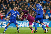 Bernardo Silva of Manchester City is challenged by Joe Bennett and Sean Morrison of Cardiff City during the Fly Emirates FA Cup Fourth Round match between Cardiff City and Manchester City at the Cardiff City Stadium, Wales, UK. Sunday 28 January 2018