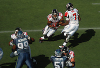 Sep 18, 2005; Seattle, WA, USA; Atlanta Falcons quarterback Michael Vick #7 hands off the ball to running back Warrick Dunn #28 against the Seattle Seahawks in the third quarter at Qwest Field. Mandatory Credit: Photo By Mark J. Rebilas
