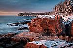 A winter sunrise on the rocky coast of Maine at Thunder Hole, Acadia National Park, ME, USA