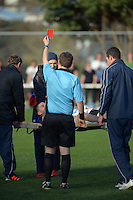 Miramar's Patrick Fleming is red-carded on a stretcher for a second yellow card offence after striking Central keeper Blaz Bugarin during the Chatham Cup semifinal football match between  Miramar Rangers and Central United at David Farrington Park, Wellington, New Zealand on Sunday, 5 August 2012. Photo: Dave Lintott / lintottphoto.co.nz