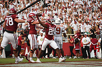 Arkansas running back Dominique Johnson (20) celebrates a score, Saturday, September 11, 2021 during the first quarter of a football game at Reynolds Razorback Stadium in Fayetteville. Check out nwaonline.com/210912Daily/ for today's photo gallery. <br /> (NWA Democrat-Gazette/Charlie Kaijo)