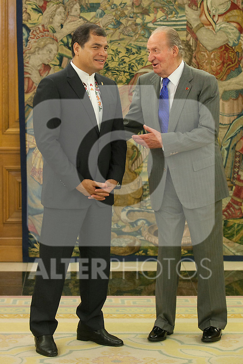 King Juan Carlos of Spain (R) receives the President of the Republic of Ecuador Rafael Vicente Correa during an audience at Zarzuela Palace in Madrid, Spain. April 24, 2014. (ALTERPHOTOS/Victor Blanco)