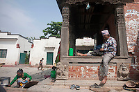 A man who lost his house in the earthquake, takes care of his cloths in Shankum, Kathmandu, Nepal. May 9, 2015