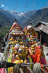 Local gods from the villages of Vashisht and Kosla during the Dussehra Festival.The Dussehra Festival is held in October or early November each year. At this time  Raghunathji (Lord Rama), the presiding Deity of the Kullu Valley, is brought from the Raghunath Temple to Dhalpur Maidan in Kullu. There are around 360 village devtas (gods) and they are carried down from each village to Kullu to pay homage to Lord Raghunathji and to attend the assembly of the gods.The festival celebrates the victory of good over evil, when Lord Rama defeated Ravana the demon king of Lanka. .Kosla,Kullu Valley, Himachal Pradesh, India,