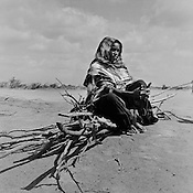 A Somali refugee sits with a pile of wood that she collected to build her shelter at the IFO-1 camp in the Dadaab refugee camp in northeastern Kenya. Hundreds of thousands of refugees are fleeing lands in Somalia due to severe drought and arriving in what has become the world's largest refugee camp. Photo: Sanjit Das/Panos
