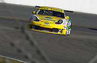 .The RWS  Motorsport Porsche 996 under braking for  the entry to the infield...