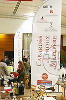 Cabardes, Limoux, Malpere, St Chinian banners and exhibitors at wine fair. Languedoc. France. Europe.