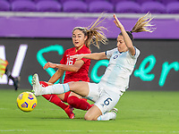 ORLANDO, FL - FEBRUARY 21: Janine Beckie #16 of Canada crosses the ball in front of Aldana Cometti #6 of Argentina during a game between Canada and Argentina at Exploria Stadium on February 21, 2021 in Orlando, Florida.