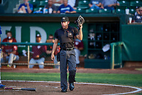 Umpire Rene Gallegos handles the calls behind the plate during a game between the Ogden Raptors and the Idaho Falls Chukars at Lindquist Field on August 29, 2018 in Ogden, Utah. Idaho Falls defeated Ogden 15-6. (Stephen Smith/Four Seam Images)