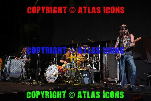 WEST PALM BEACH - SEPTEMBER 21:  Jaren Johnston, Kelby Ray, Neil Mason of Cadillac Three perform at the Cruzan Amphitheatre on September 21, 2013 in West Palm Beach, Florida.(Photo By Larry Marano (C) 2013