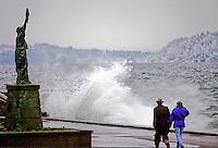 Couple walking along Alki Beach in winter, Seattle, Washington State