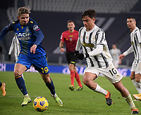 3rd January 2021, Allianz Stadium, Turin Piedmont, Italy; Serie A Football, Juventus versus Udinese;  Paulo Dybala of Juventus takes on Jens Stryger Larsen of Udinese