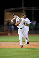 Jackson Generals third baseman Colin Walsh (8) throws to first base in front of shortstop Dawel Lugo (31) during a game against the Chattanooga Lookouts on April 27, 2017 at The Ballpark at Jackson in Jackson, Tennessee.  Chattanooga defeated Jackson 5-4.  (Mike Janes/Four Seam Images)
