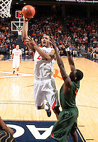 CHARLOTTESVILLE, VA- JANUARY 7: Mike Scott #23 of the Virginia Cavaliers shoots next to Malcolm Grant #3 of the Miami Hurricanes during the game on January 7, 2012 at the John Paul Jones Arena in Charlottesville, Virginia. Virginia defeated Miami 52-51. (Photo by Andrew Shurtleff/Getty Images) *** Local Caption *** Malcolm Grant;Mike Scott