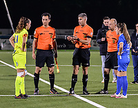 Referee Marnie Claes and assistant referee Toon Valgaeren and Robby Celis and Sien Vandersanden (10) of KRC Genk and Silke Vanwynsberghe (21) of AA Gent pictured during a female soccer game between  Racing Genk Ladies and AA Gent Ladies ,  on the 6 th  matchday of the 2021-2022 season of the Belgian Scooore Womens Super League , friday 8 october 2021  in Genk , Belgium . PHOTO SPORTPIX | JILL DELSAUX