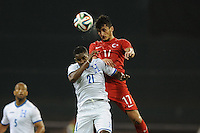 Washington, D.C.- May 29, 2014. Turkey forward Mustafa Pektemek heads the ball against Honduras defender Brayan Beckeles.  Turkey defeated Honduras 2-0 during an international friendly game at RFK Stadium.