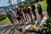"Colombian visitors read memorial cards placed on the tomb of the drug lord Pablo Escobar at the cemetery of Montesacro, in Itagüí, Colombia, 2 December 2017. Twenty five years after Pablo Escobar's death, the legacy of the Medellín Cartel leader is alive and flourishing. Although many Colombians who lived through the decades of drug wars, assassinations, kidnappings, reject Pablo Escobar's cult and his celebrity status, there is a significant number of Colombians who admire him, worshipping the questionable ""Robin Hood"" image he had. Moreover, in the recent years, the popular ""Narcos"" TV series has inspired thousands of tourists to visit Medellín, creating a booming business for many but causing a controversial rise of narco-tourism."