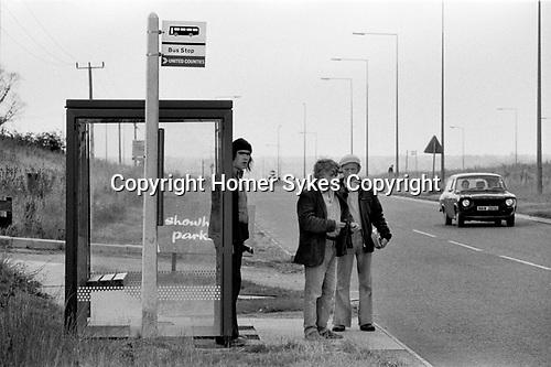 1970s England new town men waiting for a bus to take them to work.  1977  Milton Keynes Buckinghamshire.